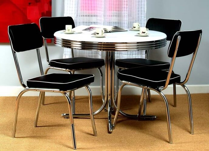 The laminate tabletop is based on a multilayered construction, allowing for a sturdy, appealing, yet wear-resistant surface. Our example here is a white PVC laminated table with chrome ring frame.