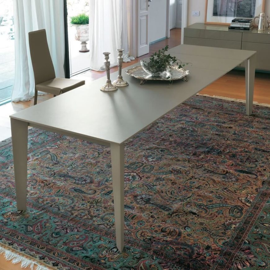 Modern style evokes a graceful mixture of utility and aesthetics that flourished beginning in the 20th century, with clean lines and sharp angles framing unfussy surfaces. This table brings a thin, airy element to any room.