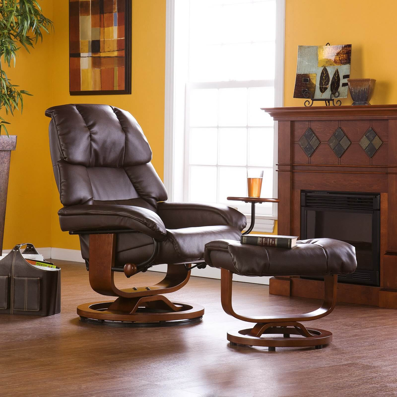 Certain recliner designs replace the built-in foot rest with a full matching ottoman. Our swivel mounted example here features plush leather upholstery over a rich wood frame.