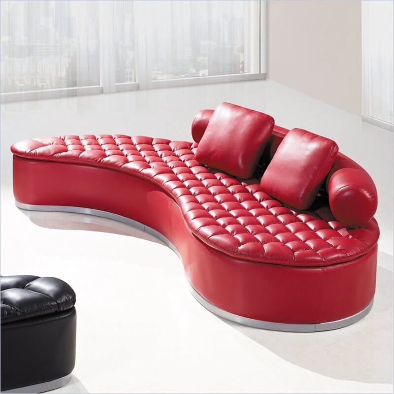 Another elegant, bold and ultra comfortable option is this bright red kidney-shaped sectional sofa, complete with biscuit tufting detail on the seat and a rounded backrest. The upholstery is a rich bonded leather.