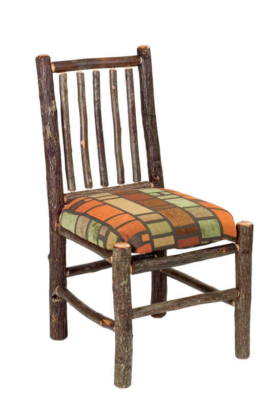"""Rustic style evokes a pastoral, old fashioned sense through unpolished natural wood, rough hewn edges, and a playfully loose design. Our featured chair consists of """"log"""" style frame with patterned upholstered seat."""