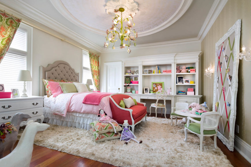 The whole of the bedroom is full of whimsy, soft textures, and bright colors. While the current decor is for a very young girl, the built-in desk, memo board, and large bed means there's room to grow without purchasing a whole new bedroom set.