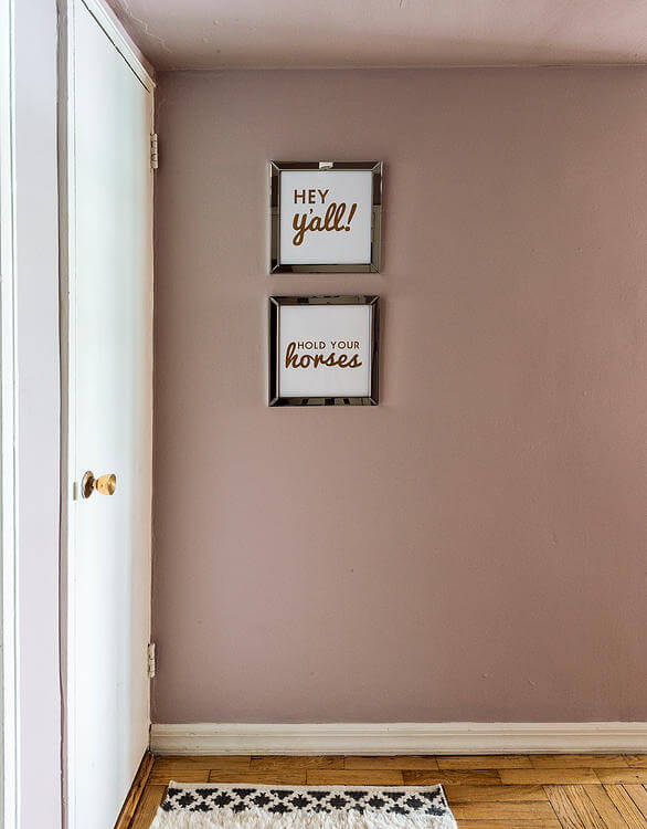 A light salmon hue coats the walls near the front door, lending a warm and bright tone as one enters the home.