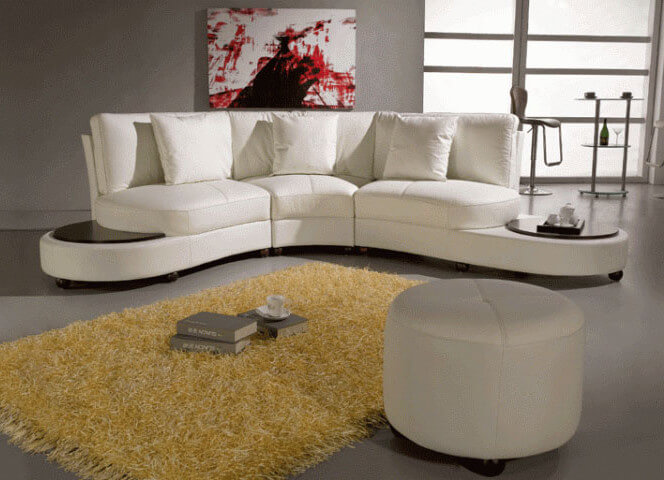 This modern look leather sectional comes in three pieces, with hardwood tabletop sections bookending the structure.