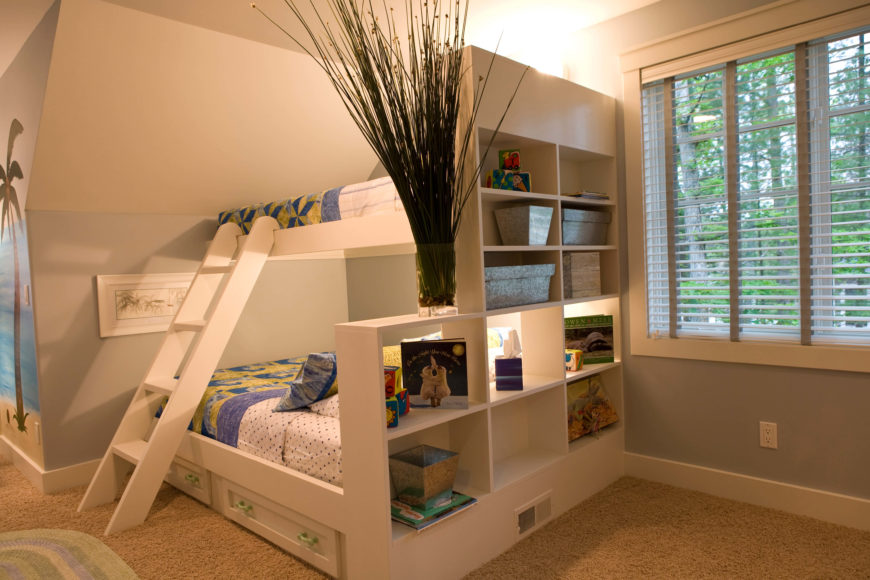 The built-in bunk bed is bored by large shelving wall at right, with pull-out storage below.