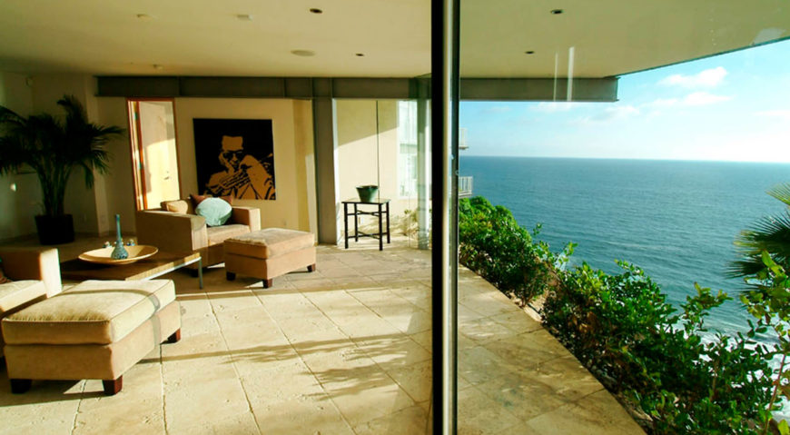 Lacking a balcony, this level has the most direct view toward the ocean, with only greenery surrounding the glass.