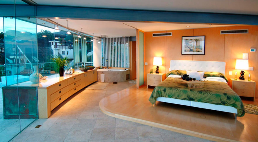 The primary bedroom and bathroom en suite defines the bed with raised hardwood platform and retractible dividing wall.