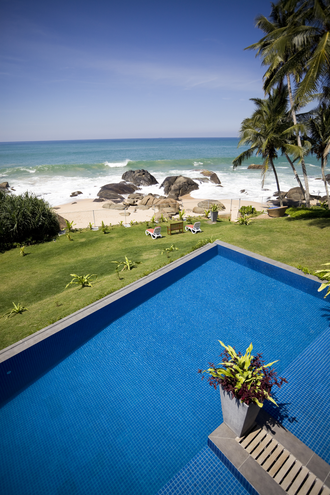 This private pool is enormous and looks out over the beach, which is fenced off from the rest of the property.