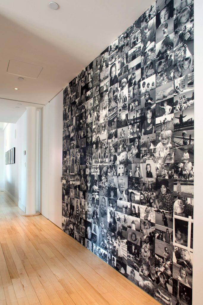 Here is the spectacular photography wall. All images were taken by the homeowner, and crafted into a custom wallpaper piece by the designers.