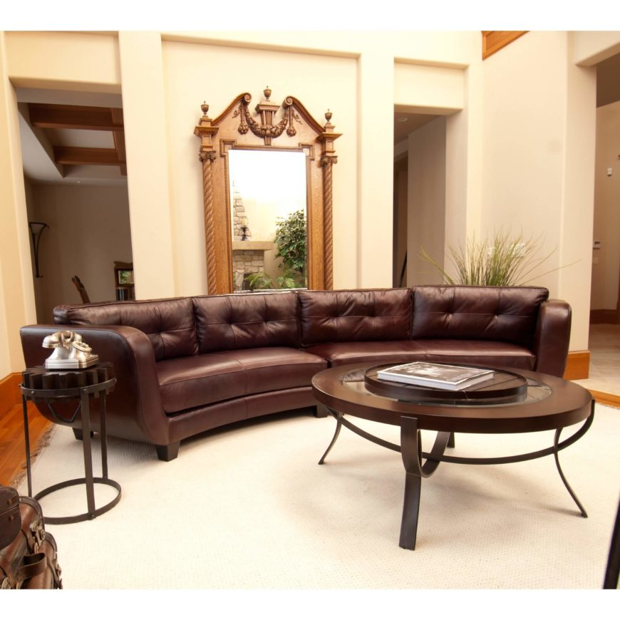 This lengthy two-piece sectional features a hardwood frame wrapped in top grain leather. Button tufted back cushions add a plush component to the clean lines and stately style.