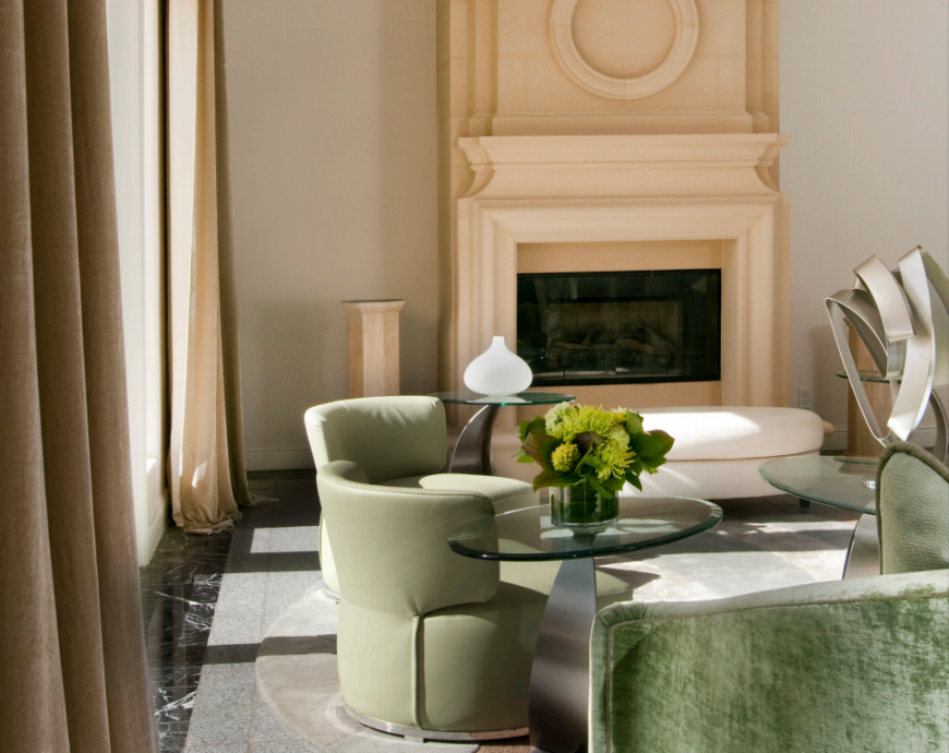 The series of oval coffee tables ensure that there is always a place to set a drink when guests are being entertained. The modern sculpture in the center acts as a visual focal point.