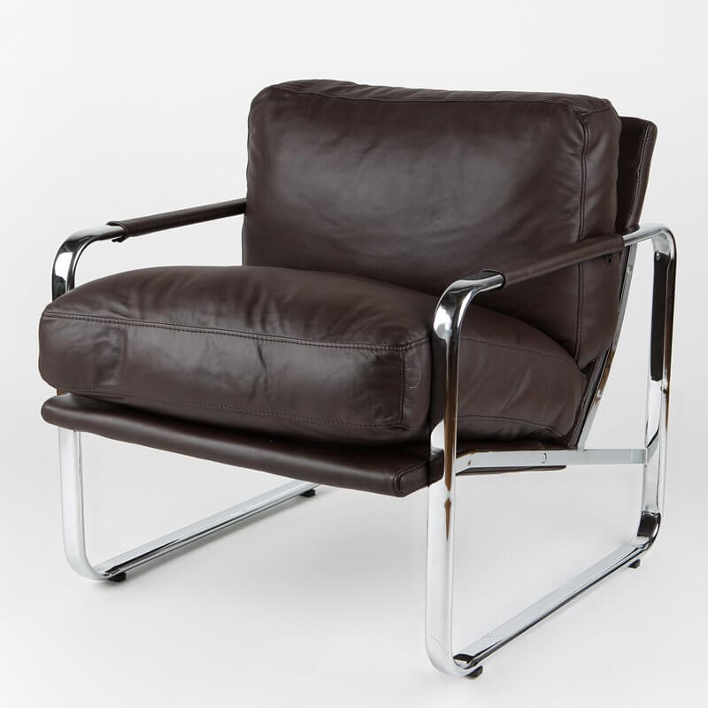 This chair features a high contrast look, with chromed metal frame supporting a chocolate leather upholstered body, with ultra-plush cushioning for back and seat.