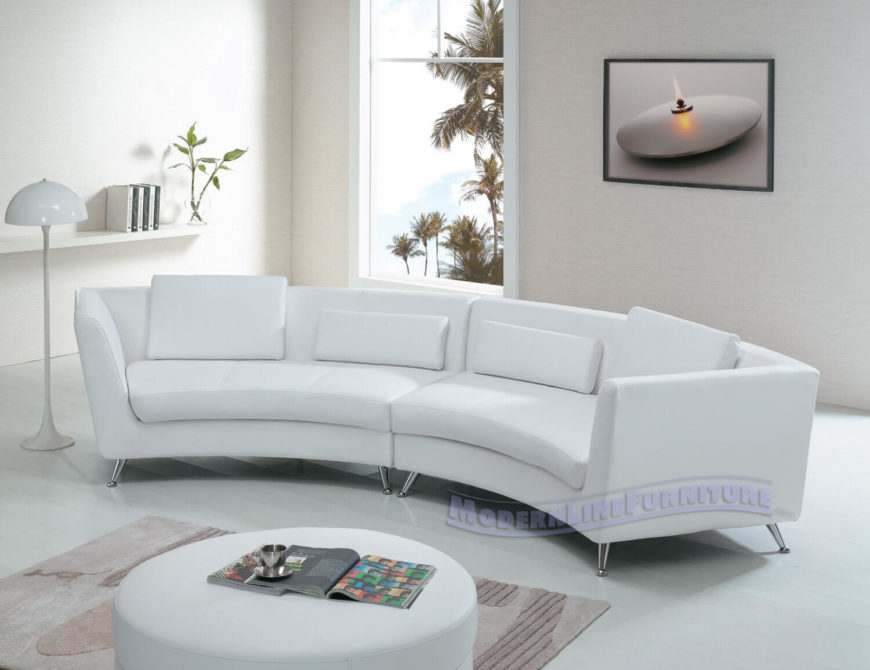 Sleek, modern design informs the look of this white leather two-piece. Chromed steel legs provide a glossy contrast to soft upholstery.