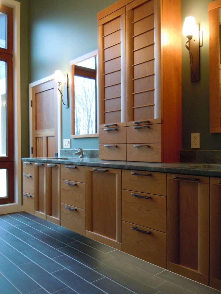 A closer view of the custom cabinetry that also highlights the beautiful tile flooring.