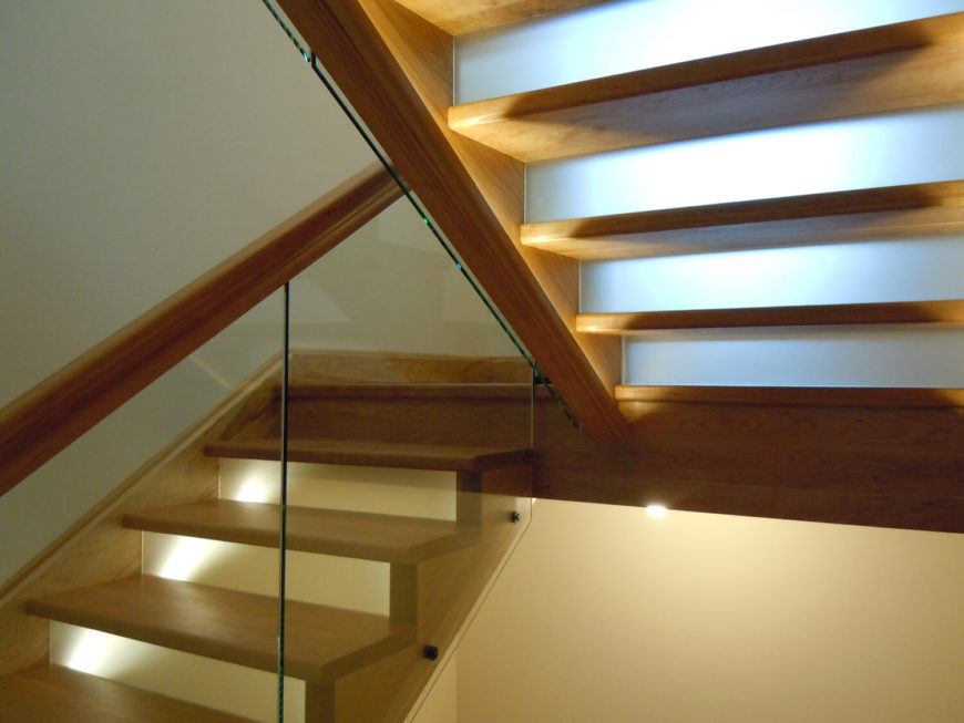 The staircases in the home are more on the modern side, with glass railings and lighting under the railings.