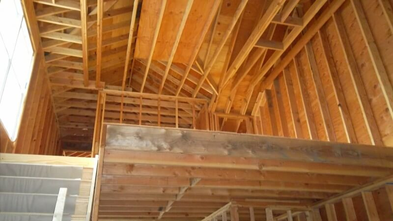 The inside of the home's second level, showing all the framing that will become soaring cathedral ceilings.
