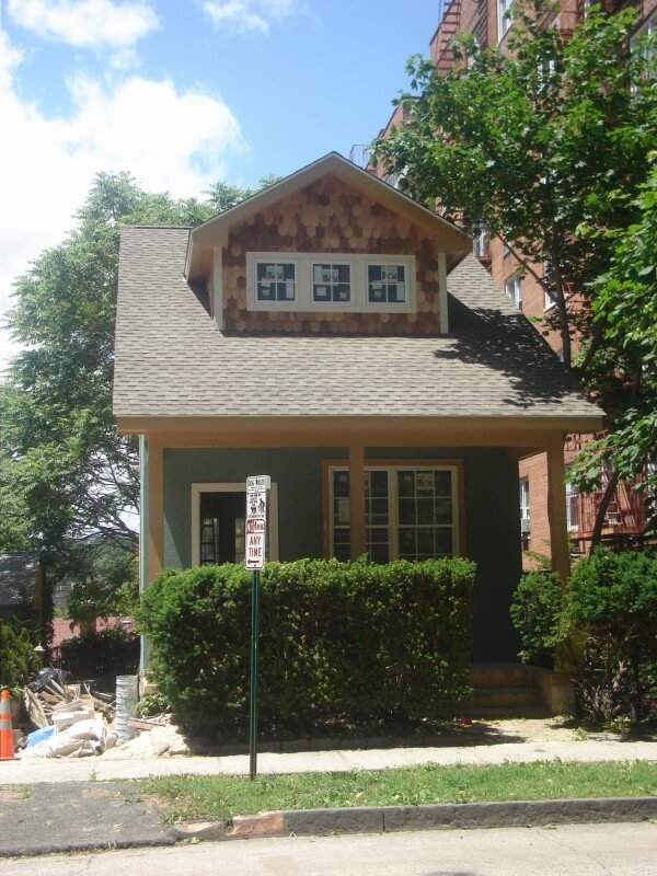 With the exterior of the home completed, the only things left to fix is the curb appeal and the overgrown hedges that hide the front porch.