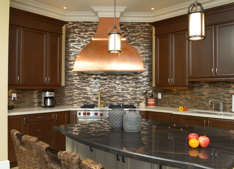 Another look at the above kitchen, paying particular attention to the copper vent hood above the range.