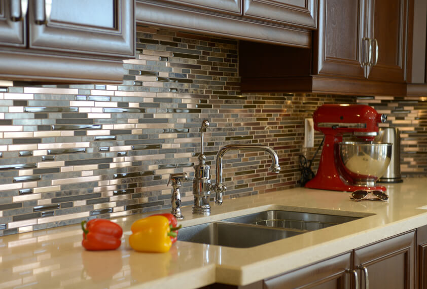 In the right light, the backsplash appears to be made out of copper, when in reality it is glass and ceramic.