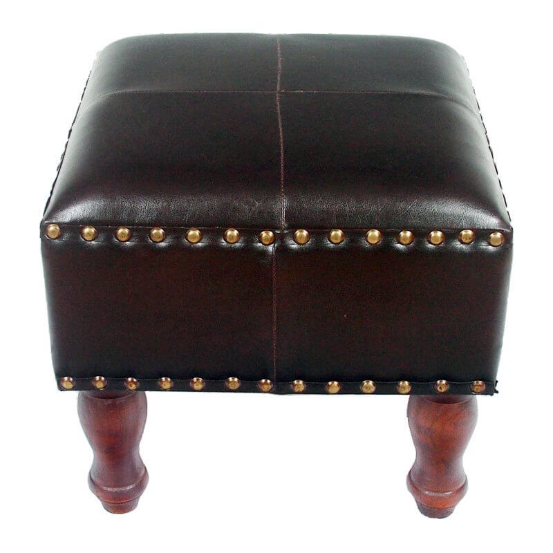 This bold square ottoman features a gold nailhead trim on the upper and lower edge of the leather wrapped seat. Tall carved wood legs add warmth and contrast.