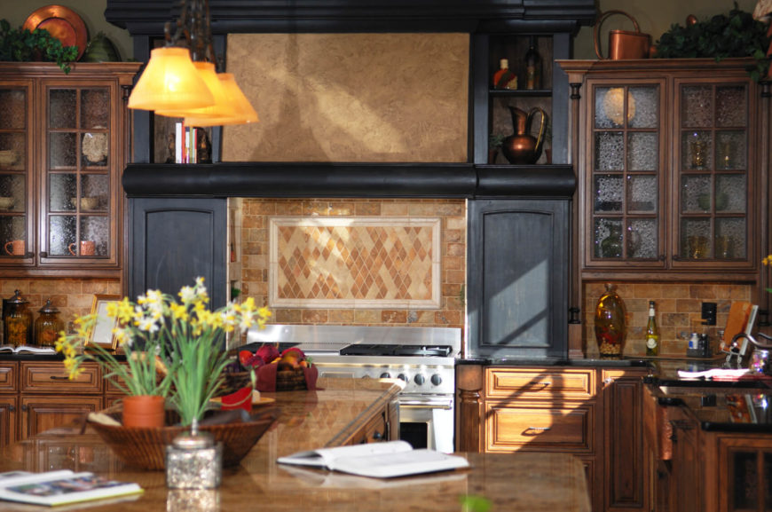 Dusky brown and red stone tiles mimic the look of light brick and keep this kitchen understated and traditional.