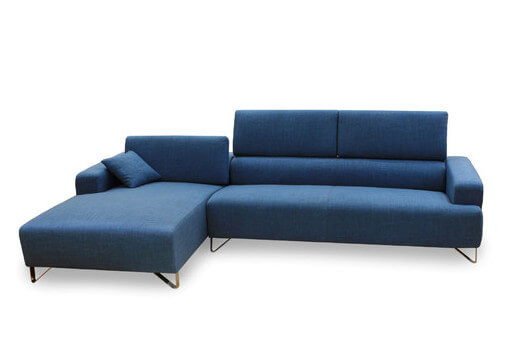 A luxurious fabric bi-sectional in a bright royal blue with chromed stainless steel legs. The three-sectioned back of the sofa gives this sectional a modern look.