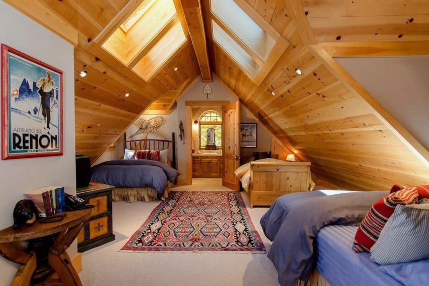 A three bed bunkroom with an adjoining bathroom on the far side of the attic.