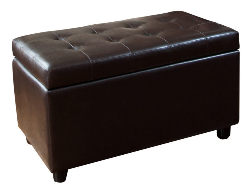 This bespoke brown leather bench ottoman stands on sleek wooden feet, with a large hinged lid hidden beneath thick button tufted cushioning.