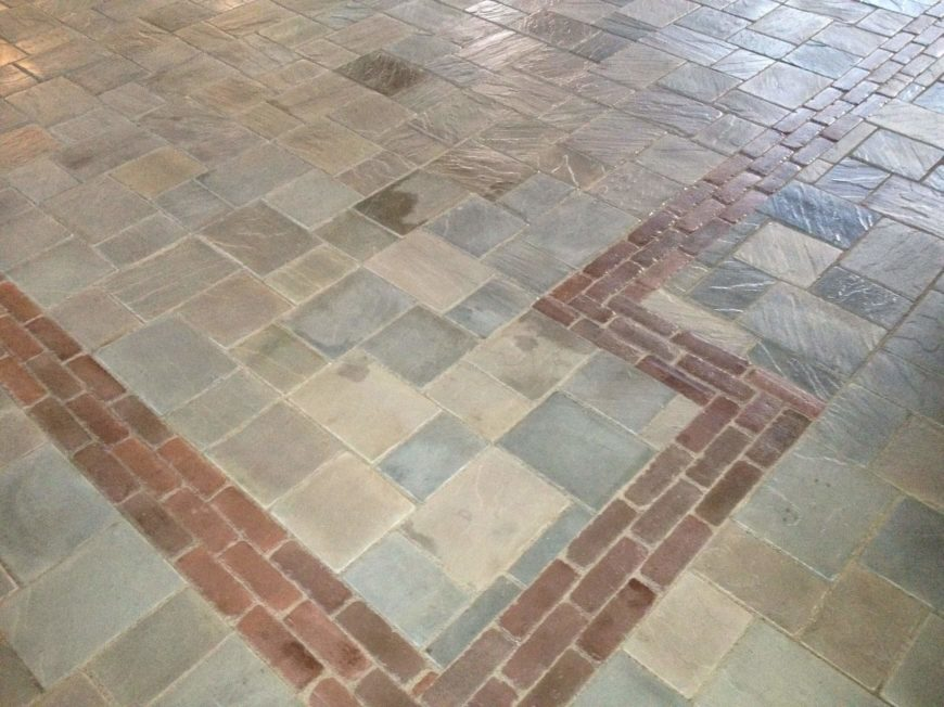 The fresh stone floor tiles involve a unique red brick pattern that wraps the room.
