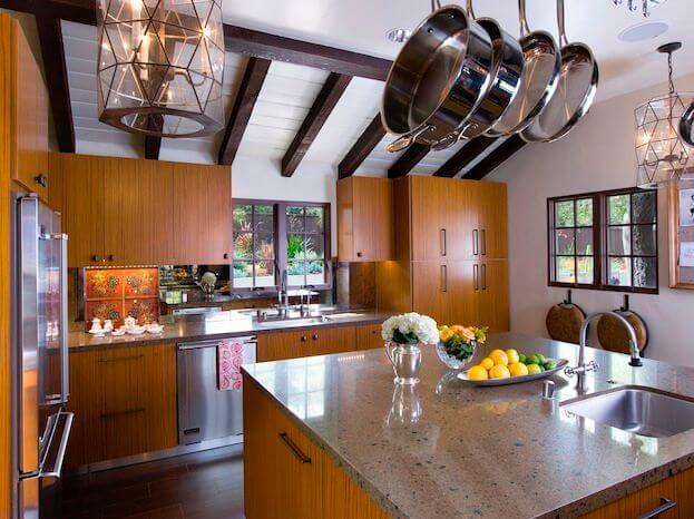 Fantastic kitchen with a pot rack and tons of cabinet space.