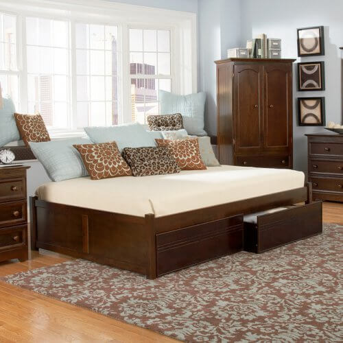 A solid platform daybed with a clean, backless design. The solid hardwood frame has two optional storage drawers on the footboard.