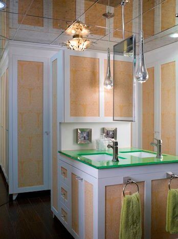 """A shot at the dual sinks on the """"island"""" of the pool house bathroom. The mirrored ceiling is a unique feature."""