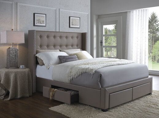 An upholstered wingback bed with button-tufting details in synthetic leather. The four storage drawers in the base provide plenty of easy-access storage.
