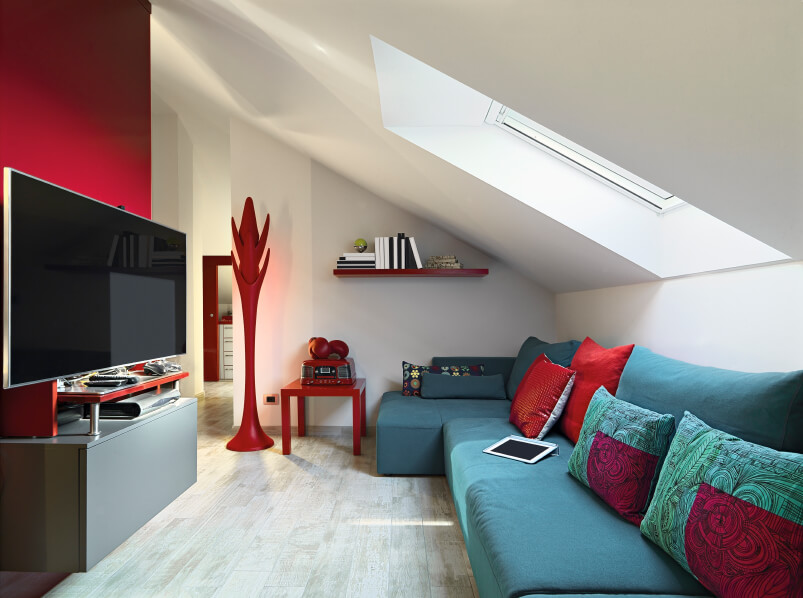 This playful little living room brings together bold colors and fun furniture. A skylight is the main source of light, and it's angled into the room to bring out the great color scheme.