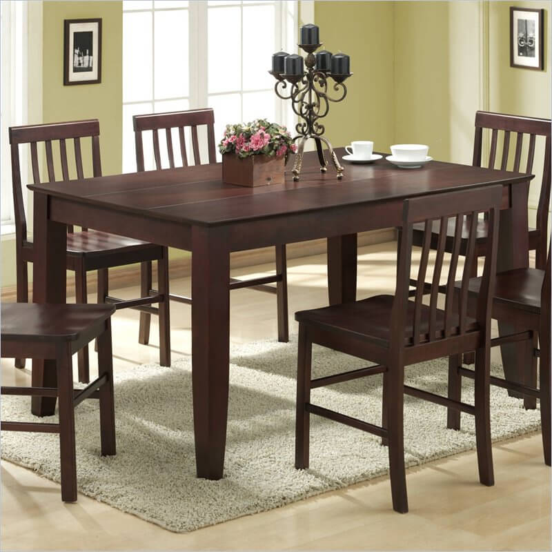 This minimalist dining room table features a rich, dark wood stain and surface divided by a pair of sleek grooves.