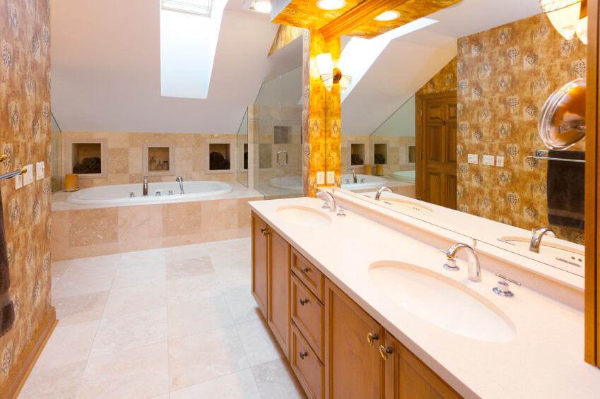 This brightly patterned bathroom is made all the more bright by carefully placed lighting fixtures and a stunning skylight.