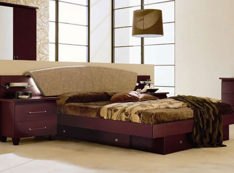 An elegant wood bed frame in a rich wine-colored lacquer and Italian leather accents with drawers beneath the main platform.