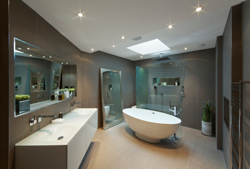 This relaxing space offers the best of modern design and optimal comfort. The deep oblong porcelain bathtub sits below a soft skylight and bursts of recessed lighting, allowing for optimal relaxation and serenity. A fully glass enclosed shower blends into its surroundings, while the double vanity offers plenty of room for daily rituals.