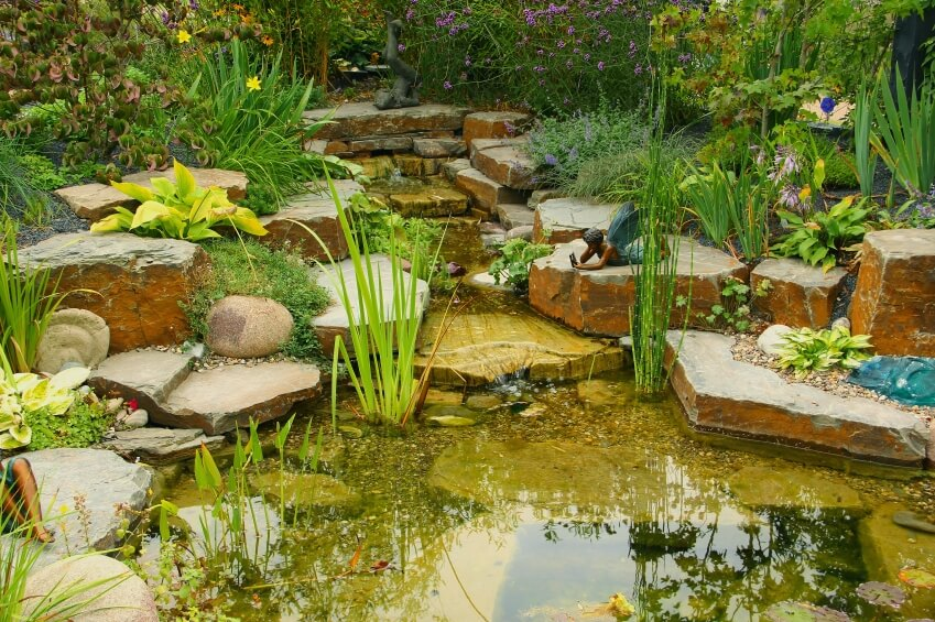 Another look at the stone waterfall and pond with the fairy sculpture. At the center of the shallow pond is a deep square well.
