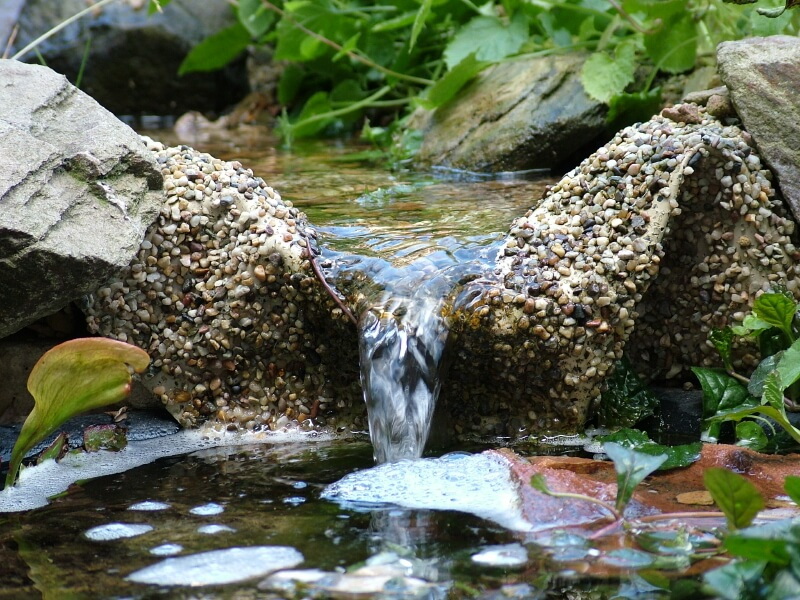 An artificial garden waterfall, when viewed very closely, is a sight to behold. Even the smallest cascades cause ripples, bubbles, and a soothing sound.