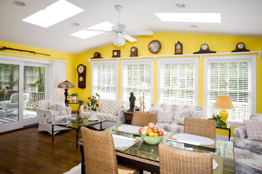 This dazzling sunflower yellow room is sure to brighten up any house. Luminous skylights add to the whimsical and joyful feeling of the room by adding a soft glow to the wicker furniture and colorful walls.