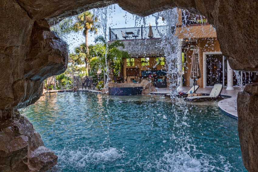 A view of a pool from inside a small cove behind the artificial waterfall.