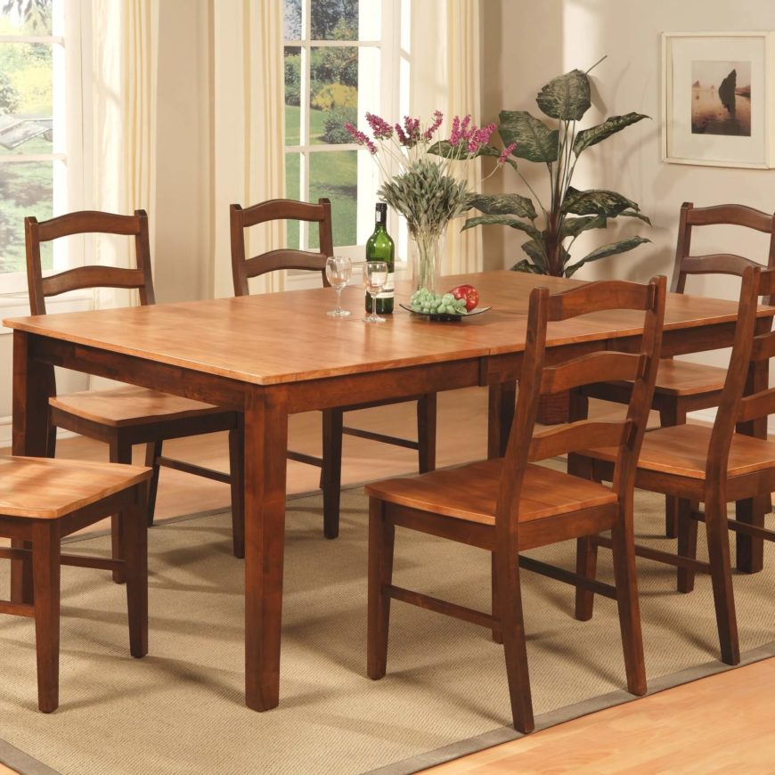 This large dining table comes in two complementary natural wood tones, with a lighter hued surface paired with dark stained legs and structure. The table features a traditional large leaf, increasing seating capacity.