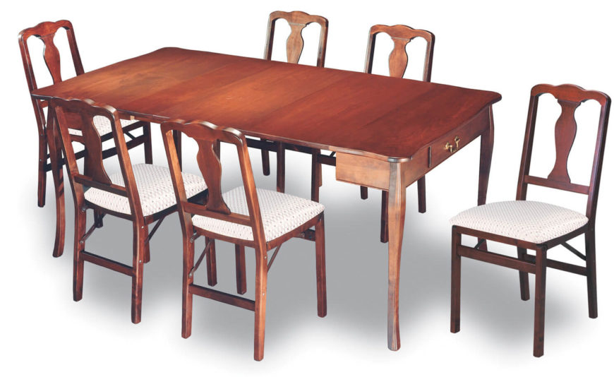 This traditionally styled, natural stained wood dining table features the aesthetic and utilitarian addition of a pair of drawers beneath the surface. Curved legs and brass hardware add to the ornate styling.