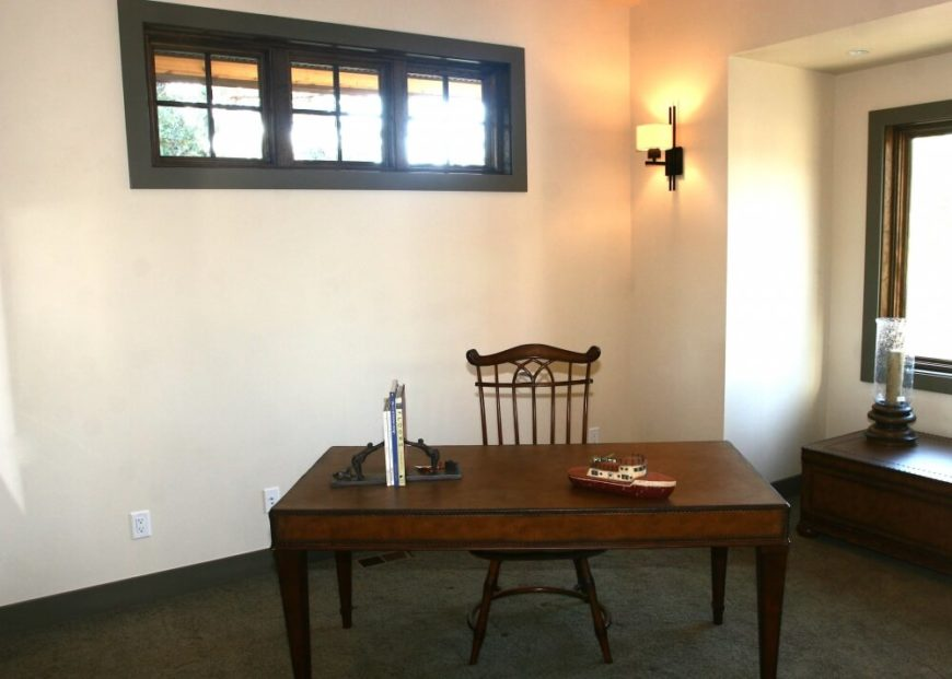The upper level's bonus room includes a small study area with beautiful antique furniture.