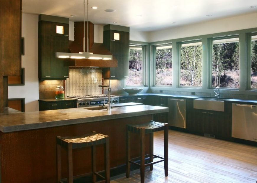 Another view of the spacious kitchen. The series of seamless windows that follow the L shape of the cabinets on the right wall light this space beautifully.