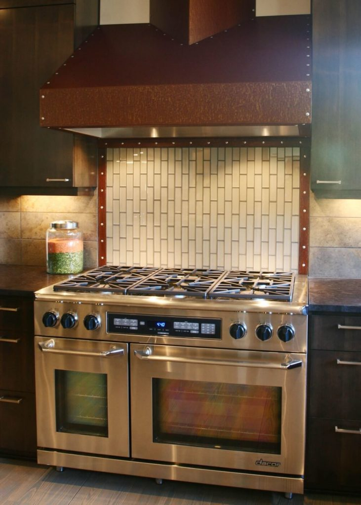 A close-up of the stove and oven, which features six burners and two ovens--perfect for cooking for a crowd.