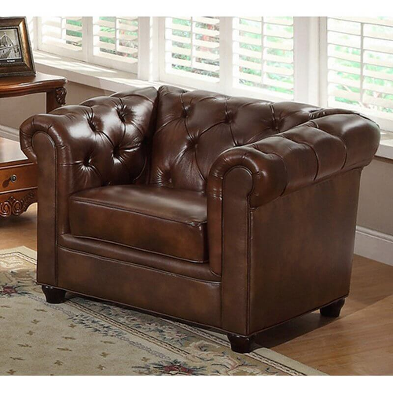This elegant leather club chair features voluptuous button tufted cushioning, wrapping around roll-arms and back. Thick cushioning and squat legs make for a sturdy, comfortable chair.