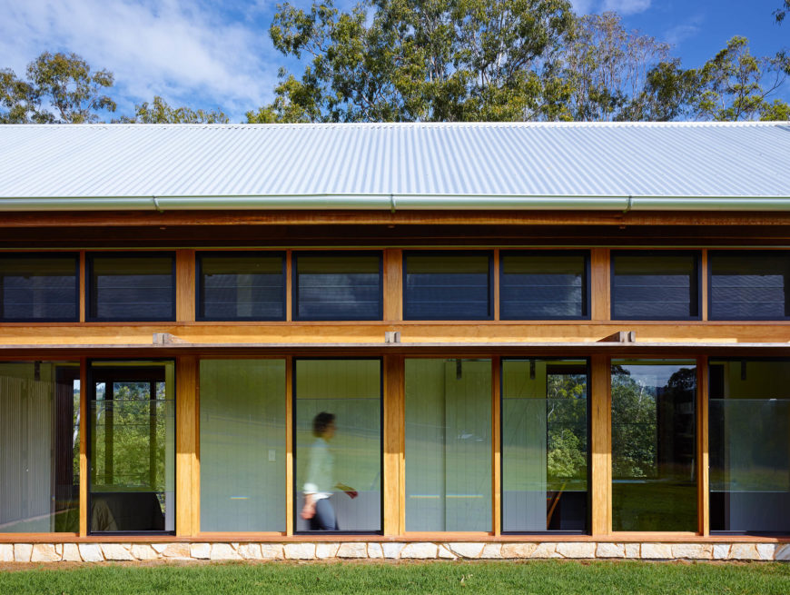 Exterior is flush with arrays of full height windows, allowing for extensive natural light and views in any part of the home.