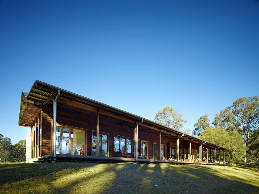 With this wide angle view of the entire structure, we see the lightweight aluminum roof looming over the lengthy veranda and series of windows and glass doors allowing fresh air and light into the home.